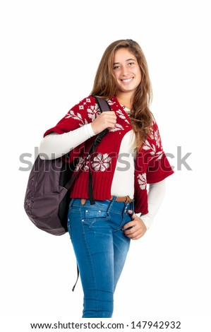 Beautiful teen girl posing with a school backpack isolated in white