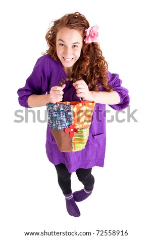 Beautiful teen girl with a little bag on white background