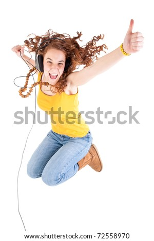 Beautiful teen girl, yellow t-shirt and jeans, jump - stock photo