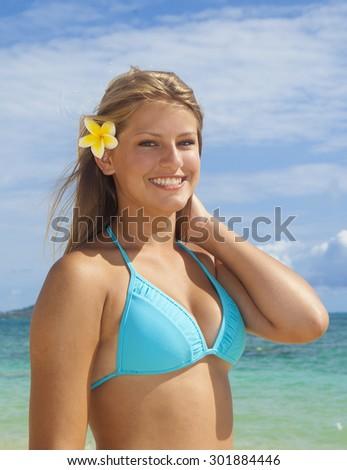 beautiful teen in bikini at a hawaii beach - stock photo