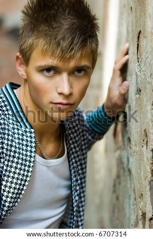 Beautiful  teen in white t-shirt posing against grunge background - stock photo