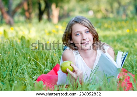 Beautiful  teenage girl in grass