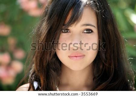 Beautiful teenage girl on a sunny day - stock photo