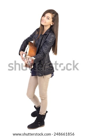 Beautiful teenage girl playing guitar and singing isolated on white background  - stock photo