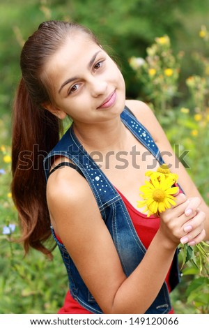 beautiful teenage girl portrait outdoor with copyspace. Soft summer colors