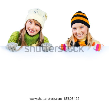 Beautiful Teenage Girls holding blank sign billboard. Space for Your Text - stock photo