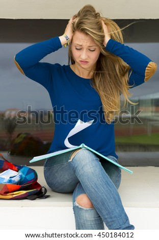 Beautiful teenage student with a stressed expression worried with something - stock photo