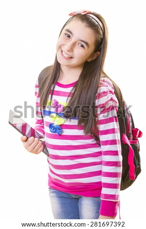 Beautiful teenager girl in casual clothes with backpack holding digital tablet in her hand - stock photo