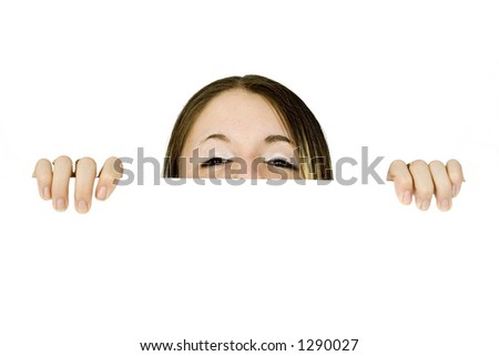 beautiful teenager peeping over a banner over a white background, shot in studio