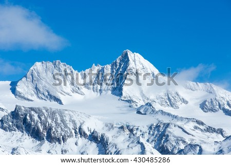 Beautiful telephoto shot of Austria's highest mountain, the Grossglockner, on a sunny winter day. - stock photo