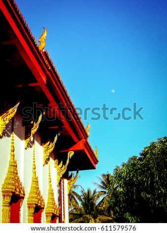 Beautiful temple roof and surrounding forest, on a sunny day. Taken on Ko Pha Ngan, Thailand.