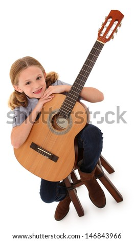 Beautiful ten year old with acoustic guitar over white with clipping path. - stock photo
