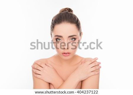 Beautiful tender young woman posing with crossed hands and touching her shoulders - stock photo