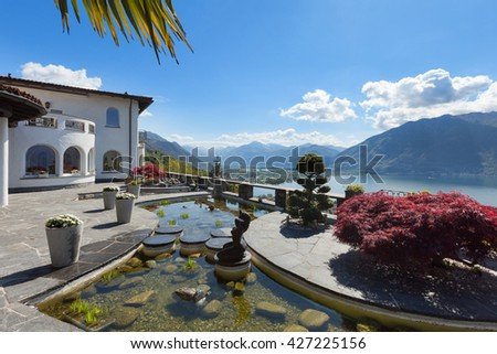 beautiful terrace with ornamental garden of a villa, lake view