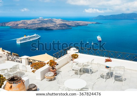 Beautiful terrace with sea view. White architecture on Santorini island, Greece. - stock photo