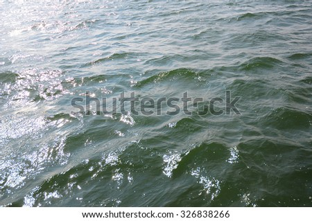 Beautiful Textured Sea Waves Background with with Sunlight - stock photo