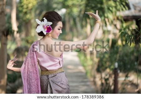 Beautiful Thai girl in Thai traditional costume - stock photo