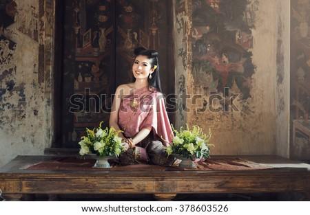 Beautiful Thai Girl in Traditional Dress Costume - stock photo