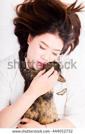 beautiful Thai girl with cat - stock photo