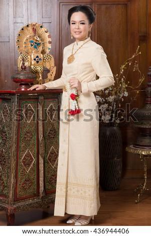 Beautiful Thai woman wearing Thai traditional culture cloth. Thai ancient culture. - stock photo