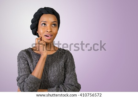 Beautiful thoughtful black woman looking up - stock photo