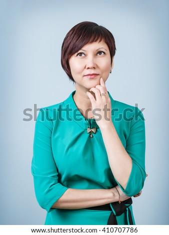 Beautiful thoughtful woman - stock photo