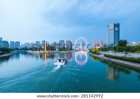 beautiful tianjin scenery of haihe river  in cloudy at dusk ,China - stock photo