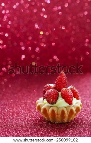 Beautiful tiny cupcakes with wild strawberries - stock photo