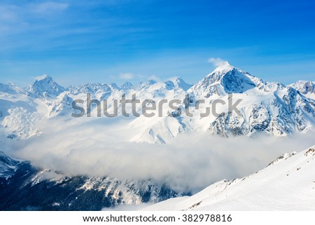 beautiful top veiw of Dombaj mountains with clouds and valley - stock photo
