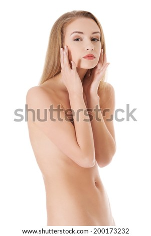 Beautiful topless woman with fresh clean skin. Isolated on white.