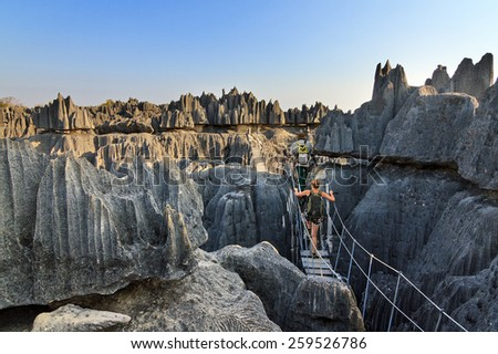 Beautiful tourist on an excursion in the unique limestone landscape at the Tsingy de Bemaraha Strict Nature Reserve in Madagascar - stock photo