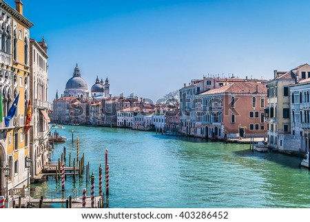 Beautiful touristic attractive Venice with view on Grand Canal and lovely cityscape during sunny day. / Venice during sunny day, Italy. - stock photo