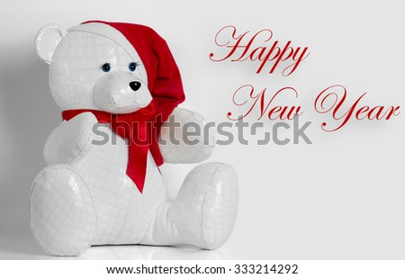 beautiful toy bear wishes Happy New Year - stock photo
