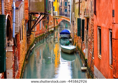 Beautiful traditional architecture of house among the canal in a rainy day, in Venice, Italy - stock photo