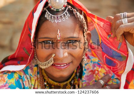 Beautiful Traditional Indian woman in sari costume covered her head with veil, India - stock photo