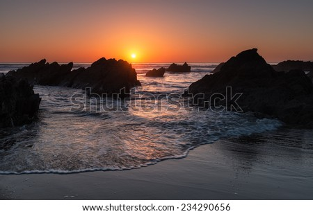 Beautiful tranquil golden beach sunset at Whitsand bay in Cornwall - stock photo