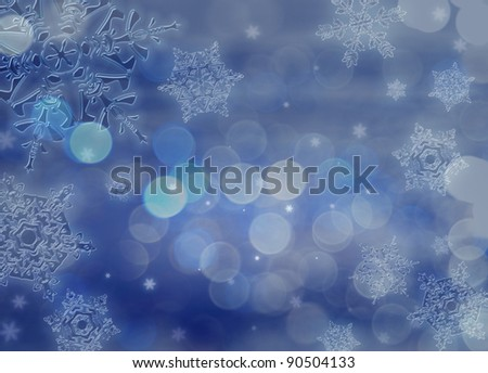 Beautiful transparent snowflakes on the background of midnight blue. Beautiful Christmas (New Year) background. Snowflakes drawn from natural water crystals. The actual proportion.