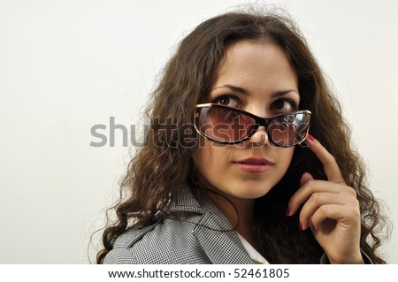 Beautiful trendy girl wearing sunglasses