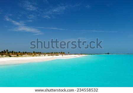 Beautiful tropical beach and turquoise Caribbean sea - stock photo