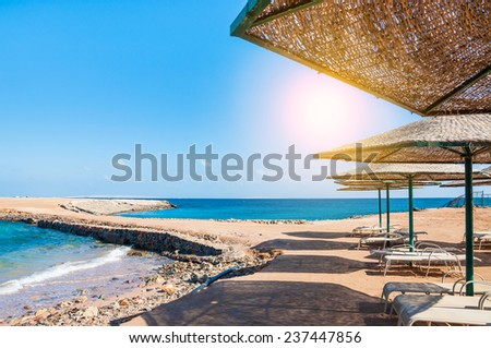 Beautiful tropical beach on the Red Sea. Summer landscape. Travel holiday background - stock photo