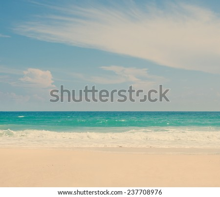 beautiful tropical beach, turquoise water and white sand, with retro instagram toning - stock photo