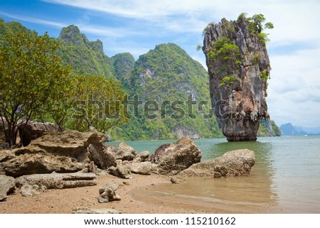 Beautiful tropical beach with big stones - stock photo