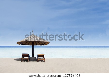 Beautiful tropical beach with blue sky and clear water - stock photo