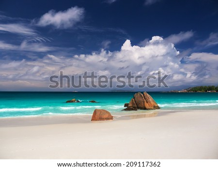 Beautiful tropical beach with rocks in the water on Seychell - stock photo