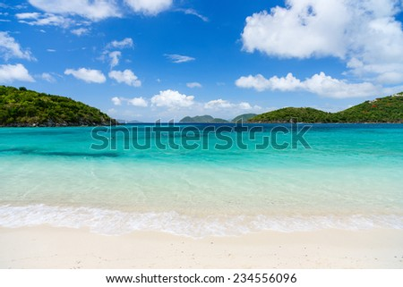 Beautiful tropical beach with white sand, turquoise ocean water and blue sky at St John, US Virgin Islands in Caribbean - stock photo