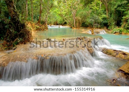 beautiful tropical landscape with cascades and streaming waterfalls  - stock photo
