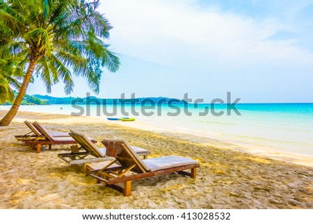 Beautiful tropical ocean or sea on the beach landscape with empty chair and blue sky background - Boost up color Processing