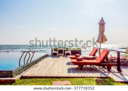 Beautiful tropical sea and beach with empty beach chair and umbrella - Vintage Film Filter effect