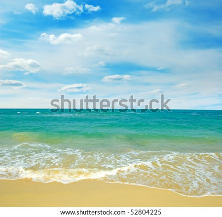 Beautiful tropical seascape with cloudy sky. - stock photo