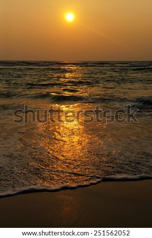 Beautiful tropical sunset in golden beach - stock photo